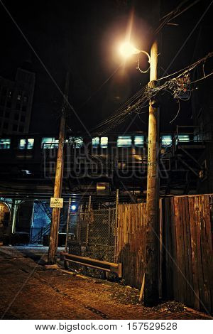 Dark City Alley at Night with Train