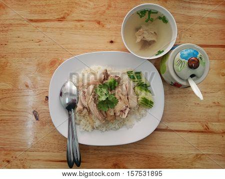 Hainanese chicken rice, Chicken background wood. rice steamed with chicken soup.