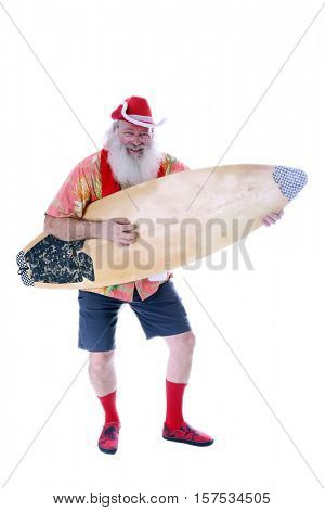 Surfing Santa. Rocker Santa. Causal Santa. Santa Claus Rocks Out with his surfboard as he plays it like an Air Guitar. Isolated on white with room for your text.