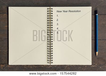 Business Concept - Top View Notebook Writing New Year Resolution.