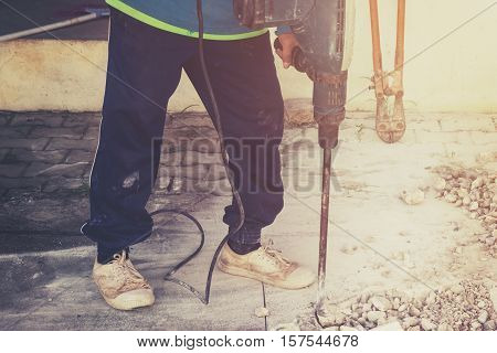 Close Up Worker Man Mason Drilling Cement Concrete Floor With Machine