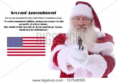 Santa Claus holds and points a 45 caliber hand gun. Santa Claus believes in the Second Amendment. Isolated on white with room for your text.