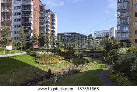 UMEA, SWEDEN ON SEPTEMBER 02. Block of modern and newly built area on September 02, 2016 in Umea, Sweden. View of a park, railway station and the hospital in the background. Editorial use.