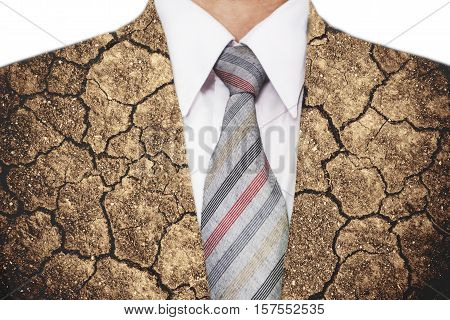 Double exposure, close-up businessman with cracked arid soil ground texture