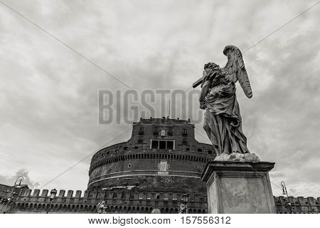 View of the Tiber in Rome on the black and white photo.