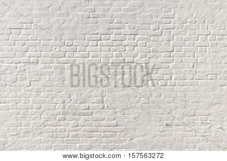 White Brick Wall Background. Whitewash Brick Wall Seamless Texture. Abstract White Backdrop. White Brickwork Wall Structure. White Painted Retro Wall Surface.