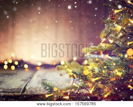 Christmas Holiday blurred Background with Christmas tree and garlands. Christmas table background. Beautiful Empty Christmas room. New Year Frame for your text