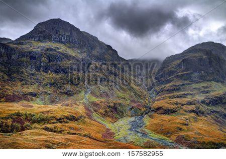 Glencoe - Three Sister. Cloudy and rainy october midday. Scottish highland Scotland.