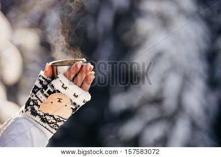 Girl Drinks Coffee In Cold Winter Forest With Snow