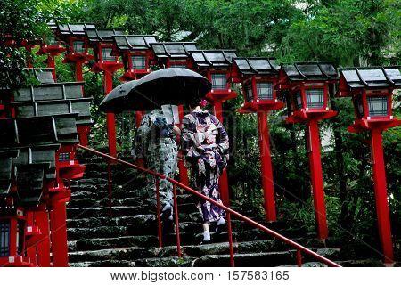 2 Kimono Ladies Struggled Through Rain To Measure Of Faith.
