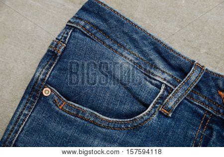 blue denim jean texture on gray background