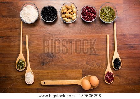 Different types of healthy uncooked proteins on a wooden table
