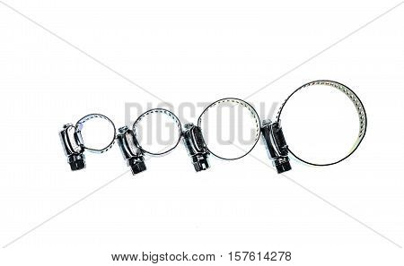 Stainless Steel Metal Hose Clamp isolated on a white background. Ideal tool for plumbers construction workers and household repairing.
