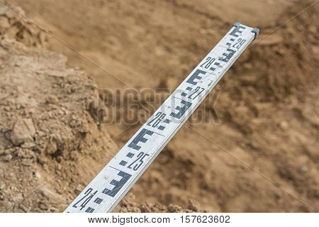 A level staff, also called levelling rod, is a graduated wooden or aluminum rod, the use of which permits the determination of differences in elevation.