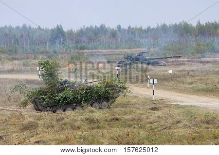 Battle tank and armoredinfantry combat vehicler during military trainings