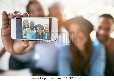 Male Hand Holding Phone And Taking Selfie