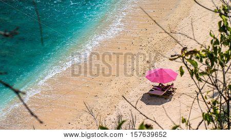 Lila Sunbed on Beautiful White Sand. Clear Blue Ocean, Atuh Beach, Nusa Penida, Bali, Indonesia.