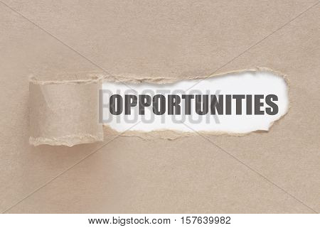Uncovering opportunities torn paper revealing a word