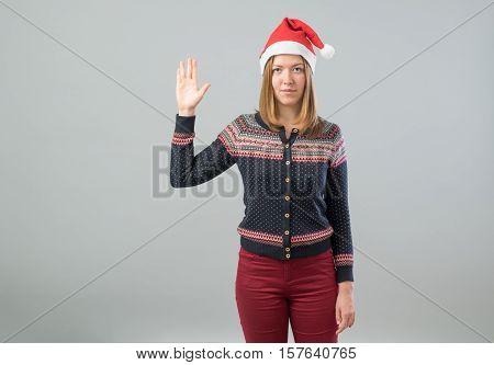 Woman Wearing Santa Hat Showing Vulcan Salute