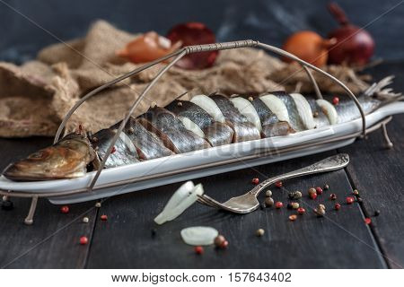 Appetizer Of Salted Herring And Onions In A Serving Dish.