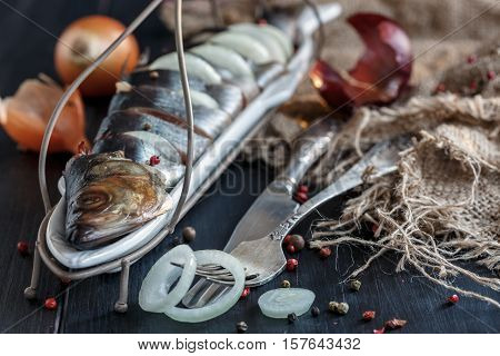 Dish With Snack Of Salted Herring, Fork And Knife.