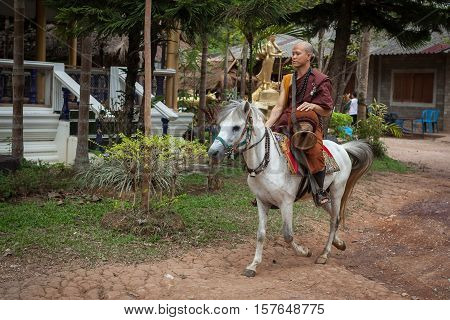 Chiang Rai, Thailand - May 21, 2016: Young Buddhist Monk On A Horse In Golden Horse Temple (wat Phra