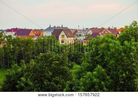 Suburban skyline. Buildings individual suburban housing in the eco-friendly district.