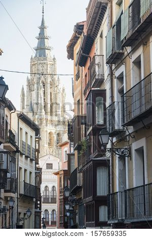 Toledo (Castilla-La Mancha Spain): old typical buildings in the historic city with verandas and belfry of the gothic cathedral