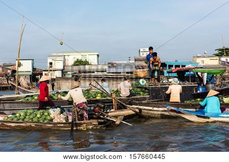 CAN THO, VIETNAM - FEB. 4: Vietnamese selling produce at the Floating Market in Can Tho, Vietnam on February 4, 2016. Cai Rang Floating Market is the biggest floating market in the Mekong Delta.