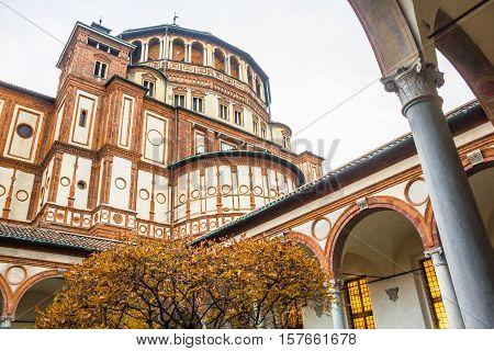 church Santa Maria Delle Grazie in Milan, Italy, from courtyard in autumn.