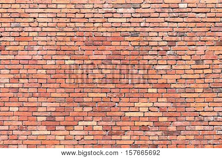 Background from an old and rough red brickwall