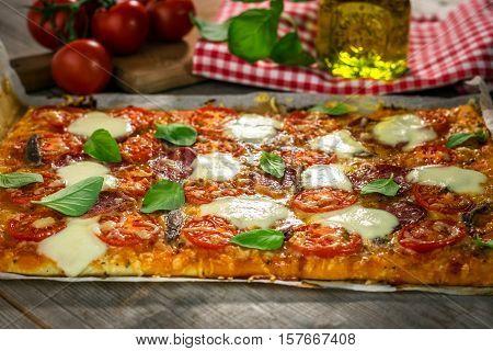 Homemade Italian Pizza With Mozzarella, Tomato And Basil Leaves