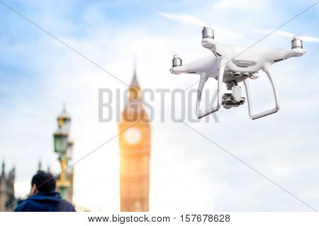 Hovering drone taking pictures of Big Ben and House of Parliament in London