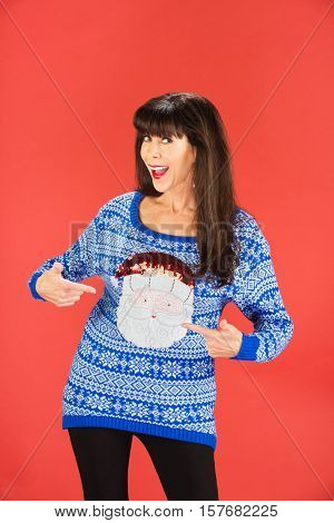Happy Woman Pointing To Her Sweater