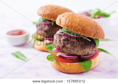 Big Sandwich - Hamburger Burger With Beef, Pickles, Tomato And Red Onions On A Light Background.