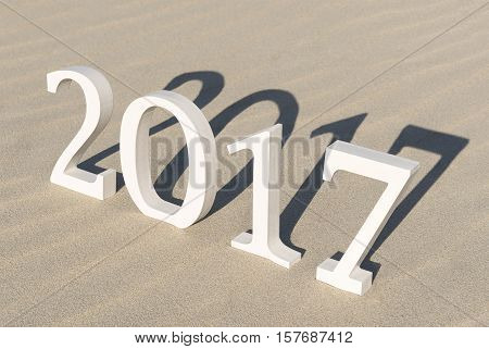 White wood figures on a beach forming the text two thousand seventeen as conceptual welcoming of the coming new year
