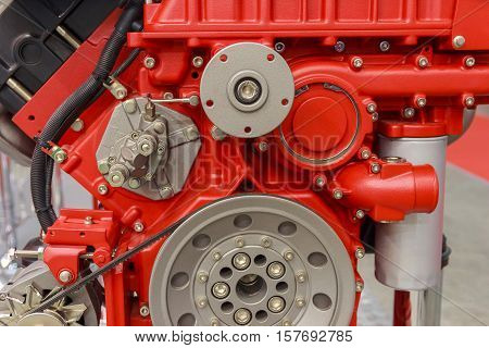 New red internal combustion engine close-up. Industry