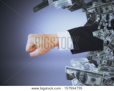 Fist with money on grey background. Breakthrough concept