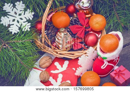 Branches of a Christmas tree on old boards. Christmas background. Christmas Socks. Christmas decorations. 2017 year. New Year background. Xmax background. Toned image.