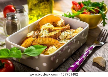 Baked Potatoes With  Cottage Cheese On  Wooden Background