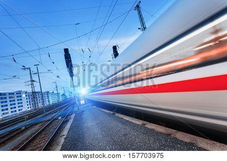Modern High Speed Passenger Train On Railroad In Motion