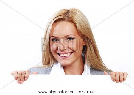 business woman hidden behind a white sheet of paper