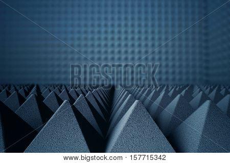 Abstract dark grey acoustic foam pyramids on dark background. 3D Rendering