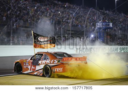 Homestead, FL - Nov 19, 2016: Daniel Suarez (19) wins  the Ford EcoBoost 300 and the 2016 Xfinity Series Championship at the Homestead-Miami Speedway in Homestead, FL.