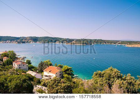 The crystal clear sea surrounding the island of Rab Croatian tourist resort.