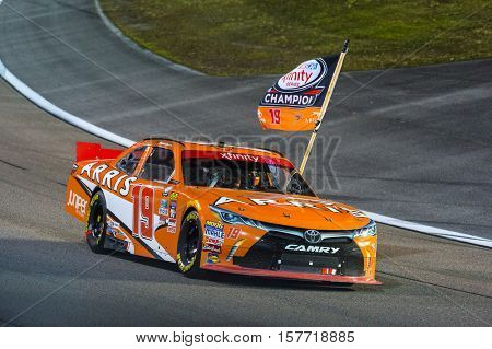 Homestead, FL - Nov 19, 2016: Daniel Suarez celebrates his victory in the #19 ARRIS  during the Ford EcoBoost 300 weekend at the Homestead - Miami Speedway in Homestead, FL.