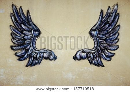 Drawn wings on textured background. Freedom concept