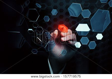 Businessman's hand aiming red dart at abstract flying honeycomb particles. Targeting concept. 3D Rendering