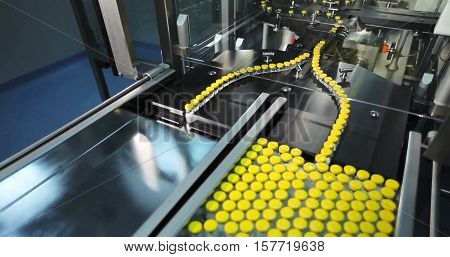 Automated line for marshalling bottles of medicines.