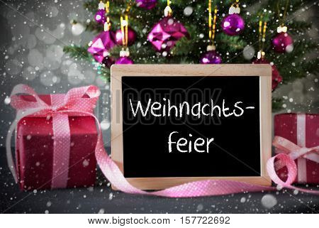 Chalkboard With German Text Weihnachtsfeier Means Christmas Party. Christmas Tree With Rose Quartz Balls, Snowflakes And Bokeh Effect. Gifts Or Presents In The Front Of Cement Background.